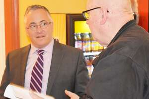 In this file photo, Reps. Vincent Candelora, left, at an event in Durham.