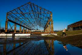 Dominic DiTullio gives a tour of the old industrial buildings that are undergoing renovations at Pier 70 in San Francisco, California, on Wednesday, March 13, 2019.