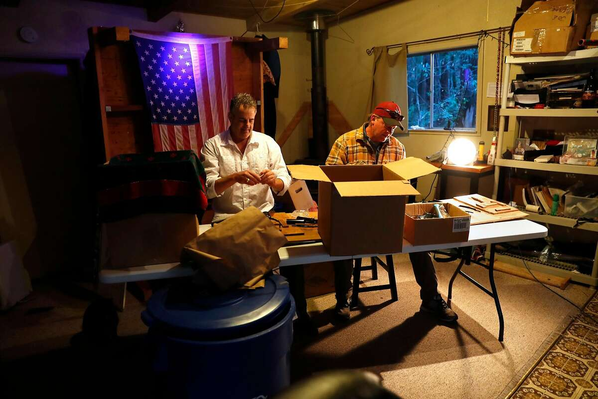 Joe Meisch (left) and his friend, Ian Barnes, assemble temple massagers that Meisch invented to relieve post traumatic stress. Photographed at Meisch's home in Cazadero, Calif., on Wednesday, March 13, 2019.