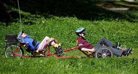 Ames Lefever (right) leads Jackie Donovan in an exercise program for persons with disabilities aboard a tandem recumbant bicycle provided by the BORP Adaptive Cycling Center at Aquatic Park in Berkeley, Calif. on Tuesday, March 12, 2019.
