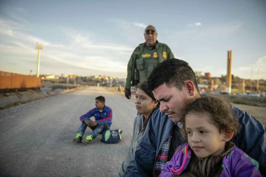 Jose Francisco Juárez and his daughters, 5-year-old Perla Victoria and 17-year-old Helen, traveled from Honduras to ask for asylum in the United States. They are part of a larger influx whose numbers  justify characterization of circumstances at the border as a crisis. Photo: Roberto E. Rosales /Associated Press / Albuquerque Journal