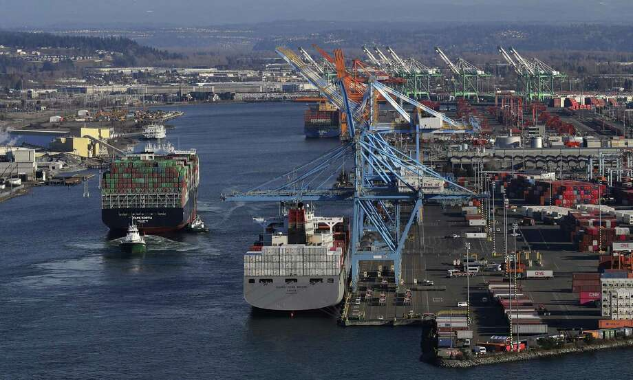 The Cape Kortia container ship, left, heads into the Port of Tacoma in Commencement Bay in Tacoma, Wash., recently. Global trade in which goods cross borders is better than what happens in the absent of that — armies crossing borders. Photo: Ted S. Warren /Associated Press / Copyright 2019 The Associated Press. All rights reserved.