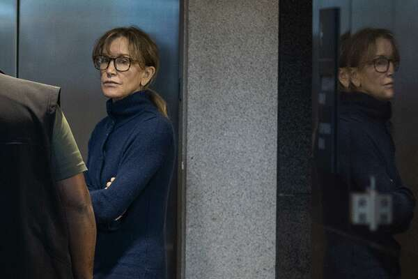 Actress Felicity Huffman, seen inside a Los Angeles courthouse last week, is among those indicted in a nationwide university admissions scam. Getting into college isn't easy - and it isn't meant to be.