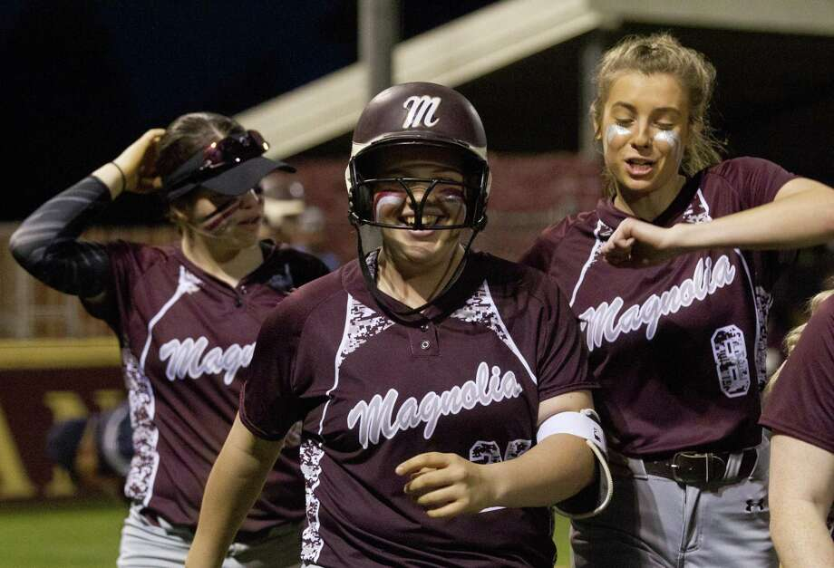 Designated hitter Jamie Holder (25) of Magnolia reacts after hitting a 2-run homer during the seventh inning of a District 19-5A high school softball game at Magnolia West High School, Monday, March 11, 2019, in Magnolia. Photo: Jason Fochtman, Houston Chronicle / Staff Photographer / © 2019 Houston Chronicle