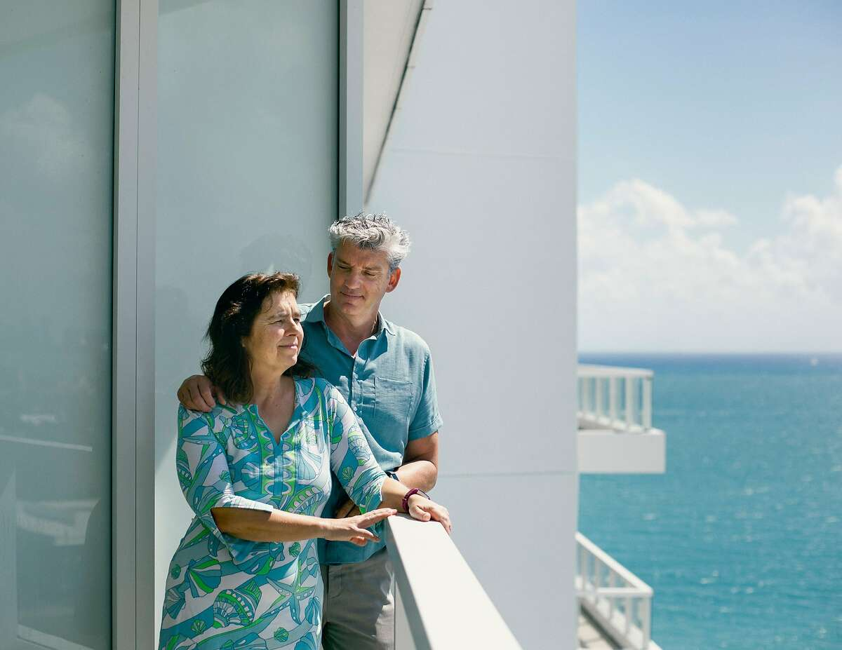 Frans and Caroline Swaalf at home in their condo at the Fontainebleau in Miami, March 9, 2019. Property investments have long been associated with wealth creation. In a recession, though, they can be risky for owners who need to sell. (Rose Marie Cromwell/The New York Times)