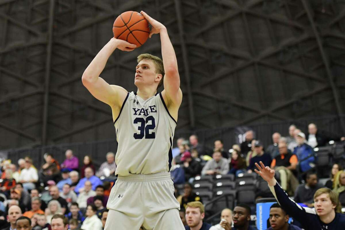 Yale's Blake Reynolds shoots a 3-point basket against Princeton during the second half at L. Stockwell Jadwin Gymnasium on March 9 in Princeton, N.J. Yale won 81-59.