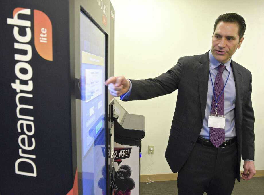 Fernando Ors, President, Sports Betting, of Intralot USA, gives a presentation on a interactive betting terminal at a Connecticut Lottery hosted interactive educational forum. The forum was to demonstrate some of the products that are available in the marketplace for online and mobile lottery and sports betting. Friday, March 15, 2019, in Rocky Hill, Conn. Photo: H John Voorhees III / Hearst Connecticut Media / The News-Times