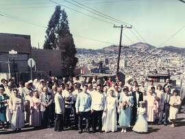 Molokan weddings included street processions from the bride's house to the church.�This one is at 22nd and Carolina in 1987. Note the men wear Russian costumes.