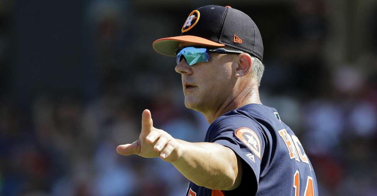PHOTOS: Free agents Houston Astros manager AJ Hinch motions to the bullpen as he walks out to the mound to make pitching change during the third inning of an exhibition spring training baseball game against the Washington Nationals Sunday, March 3, 2019, in West Palm Beach, Fla. (AP Photo/Jeff Roberson) Browse through the photos to see the top MLB free agents this offseason.