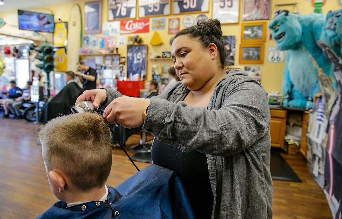 Kristyn Hansen, at Stews Barber Shop in Ladera Ranch, Calif., used to work as a contractor. With the Dynamex court ruling, she was classified as an employee. (Irfan Khan/Los Angeles Times/TNS)