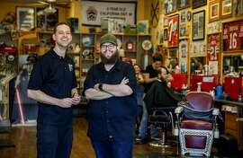 Mark Hylkema, left, and James Stewart, barbers and co-owners of Stew's Barber Shop in Ladera Ranch, Calif., had to give employee status to barbers working as contractors after the California Supreme Court.'s Dynamex decision. (Irfan Khan/Los Angeles Times/TNS)