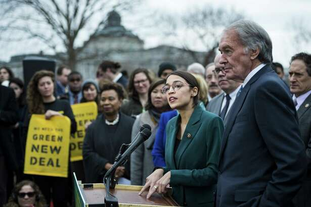 Rep. Alexandria Ocasio-Cortez (D-N.Y.) speaks alongside Sen. Ed Markey (D-Mass.) at a news conference about the Green New Deal, in Washington, Feb. 7, 2019. The technology is feasible for a Green New Deal, though experts doubt its goals could be accomplished as quickly as advocates hope. Finding money and political will is a bigger challenge. (Pete Marovich/The New York Times)