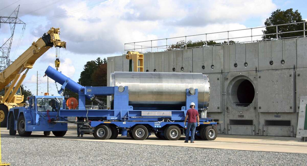In this Oct. 14, 2010 photo released by Dominion Resources, a trailer holding a spent fuel storage container is maneuvered into position for offloading into a horizontal storage module at the Millstone Power Station in Waterford.