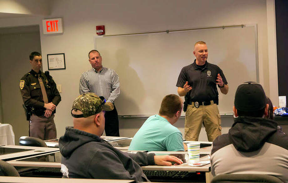 Criminal Justice professionals spoke to interested students during the first Criminal Justice Open House and Panel, March 21, 2018. Pictured, from left are: William Dimitroff, Madison County Sheriff's Department; Mike Fischer, Illinois State Police; and Brent Birschi, Alton Police Department.