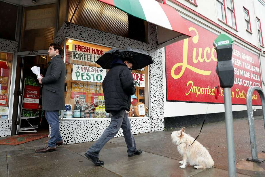After the 94-year-old Lucca Ravioli Co. in San Francisco announced it was closing in April, customers bought out its branded shirts, hats and canvas bags and have been asking for its handmade signs in the windows. Photo: Scott Strazzante / The Chronicle
