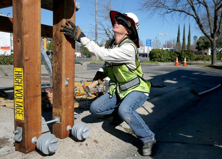Sacramento Municipal Utility District worker Lindsey Martinez prepares a new utility pole for installation on Fairfield Street in Sacramento, Calif. on Friday, March 15, 2019. SMUD is one of the largest publicly operated electric utility companies in Northern California.