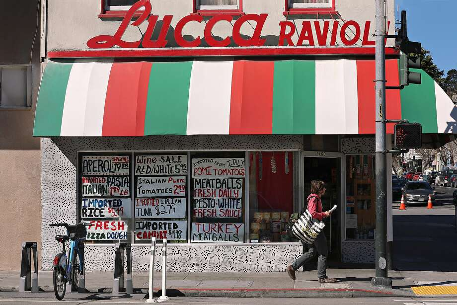 Since the 94-year-old Lucca Ravioli Co. announced it was closing, customers have been asking for its handmade signs. Photo: Liz Hafalia / The Chronicle