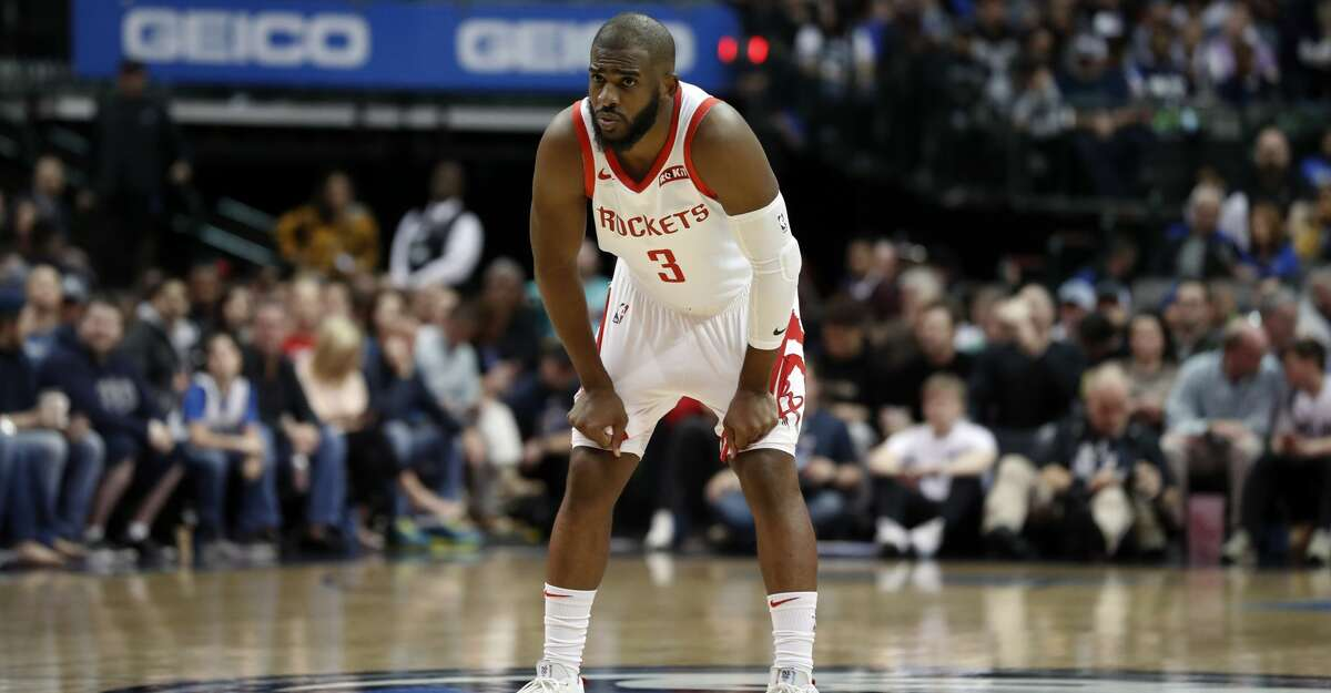 Houston Rockets guard Chris Paul (3) watches as free throws are taken during an NBA basketball game against the Dallas Mavericks in Dallas, Sunday, March 10, 2019. (AP Photo/Tony Gutierrez)
