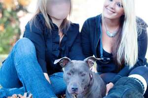 Bully Breed Rescue President Heidi Lueders, right, is shown here in this 2013 file photo.