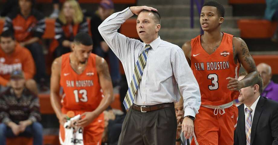 Sam Houston State coach Jason Hooten signals a play during the first half of the team's NCAA college basketball game against Clemson on Wednesday, Nov. 14, 2018, in Clemson, S.C. (AP Photo/Richard Shiro) Photo: Richard Shiro/Associated Press