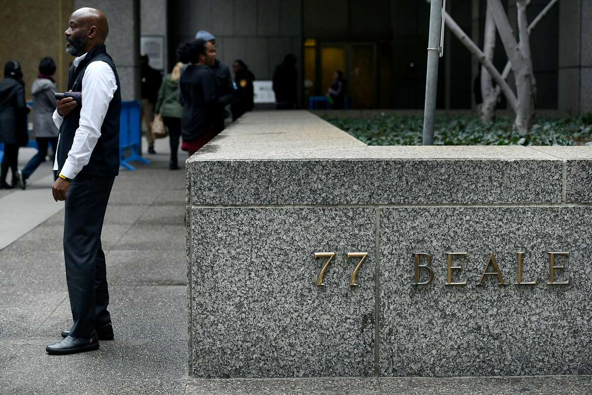 People stand outside of PG&E's headquarters in San Francisco, CA, on Monday January 14, 2019.