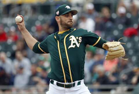 5475970d87d20f Oakland Athletics pitcher Marco Estrada throws against the San Diego Padres  during the first inning of