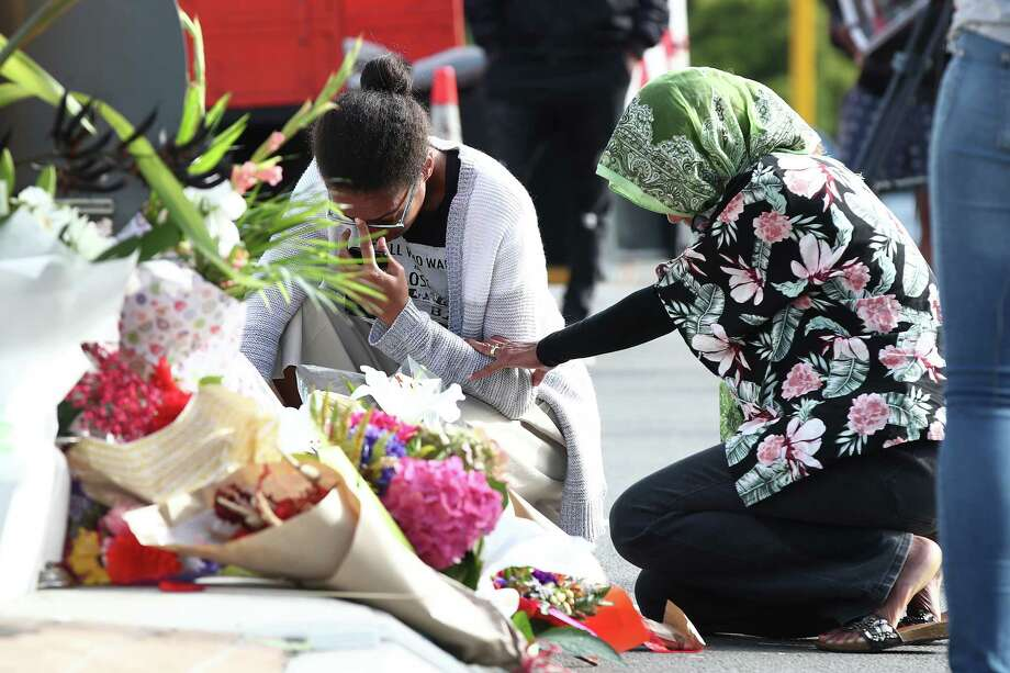 CHRISTCHURCH, NEW ZEALAND - MARCH 16: Locals lay flowers in tribute to those killed and injured at Deans Avenue near the Al Noor Mosque on March 16, 2019 in Christchurch, New Zealand. At least 49 people are confirmed dead, with more than 40 people injured following attacks on two mosques in Christchurch on Friday afternoon. 41 of the victims were killed at Al Noor Mosque on Deans Avenue and seven died at the Linwood Mosque. Another victim died later in Christchurch hospital. Three people are in custody over the mass shootings. One man has been charged with murder.  (Photo by Fiona Goodall/Getty Images) Photo: Fiona Goodall / 2019 Getty Images