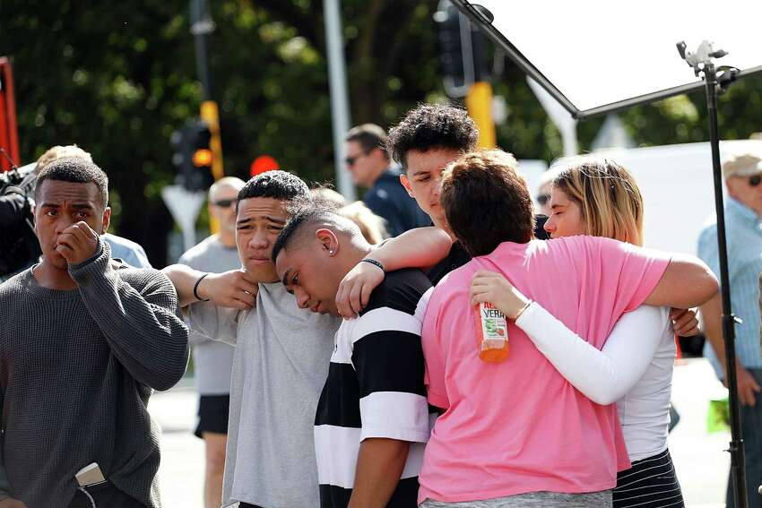 Residents get emotional as they pay respect by placing flowers for the victims of the mosques attacks in Christchurch on March 16, 2019. - New Zealand's prime minister vowed to toughen the country's gun laws after revealing Saturday that the man accused of murdering 49 people in two mosques legally purchased the arsenal of firearms used in the massacre. Jacinda Ardern said the gunman, 28-year-old Australian Brenton Tarrant, obtained a