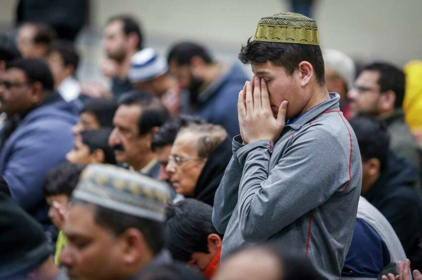 Worshippers attend a memorial service at the Al Madinah Islamic Centre in Calgary, Alberta, Friday, March 15, 2019, for the victims of the mosque shootings that occurred in New Zealand. (Jeff McIntosh/The Canadian Press via AP)