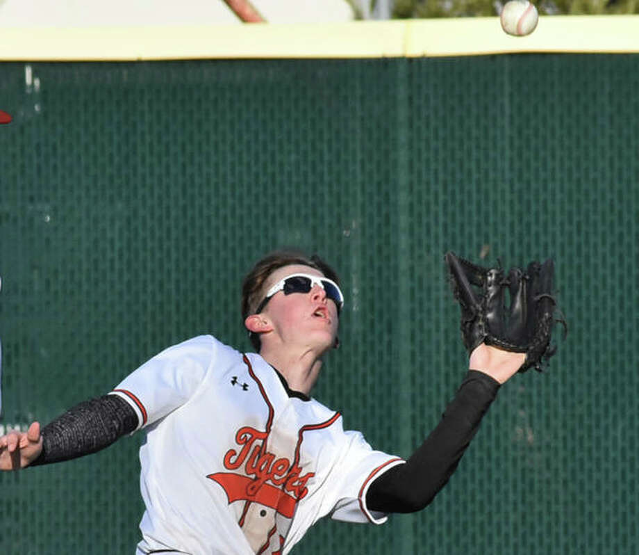 Edwardsville right fielder Hayden Moore makes a running catch Friday during the game against Brother Rice at Tom Pile Field. Photo: Matt Kamp/Intelligencer