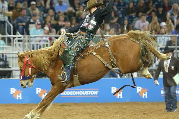 Zeke Thurston rides during the saddle bronc competition during RodeoHouston Wild Card round at NRG Stadium on Friday, March 15, 2019, in Houston.