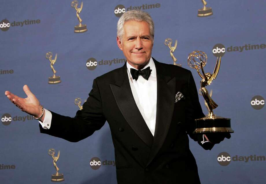 """FILE - In this Friday, April 28, 2006, file photo, Alex Trebek holds the award for outstanding game show host, for his work on """"Jeopardy!"""" backstage at the 33rd Annual Daytime Emmy Awards in Los Angeles. Canadian """"Jeopardy!"""" host Trebek announced he's been diagnosed with advanced pancreatic cancer in a YouTube video on Wednesday, March 6, 2019, that had a positive tone despite the grim prognosis. (AP Photo/Reed Saxon, File) Photo: Reed Saxon / AP2006"""