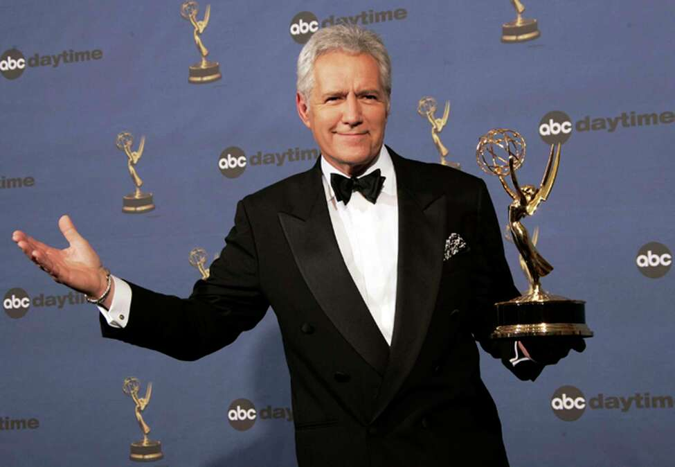 FILE - In this Friday, April 28, 2006, file photo, Alex Trebek holds the award for outstanding game show host, for his work on