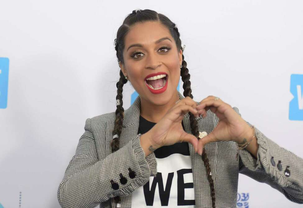 FILE - In this April 19, 2018 file photo, Lilly Singh arrives at WE Day California at The Forum in Inglewood, Calif. NBC is shaking up late-night TV, giving Carson Daly?s slot to a woman of color who?s a star on YouTube. The network said Thursday, March 14, 2019, that a new show, titled ?A Little Late with Lilly Singh,? will air at 1:35 a.m. EDT beginning in September. (Photo by Richard Shotwell/Invision/AP, File)