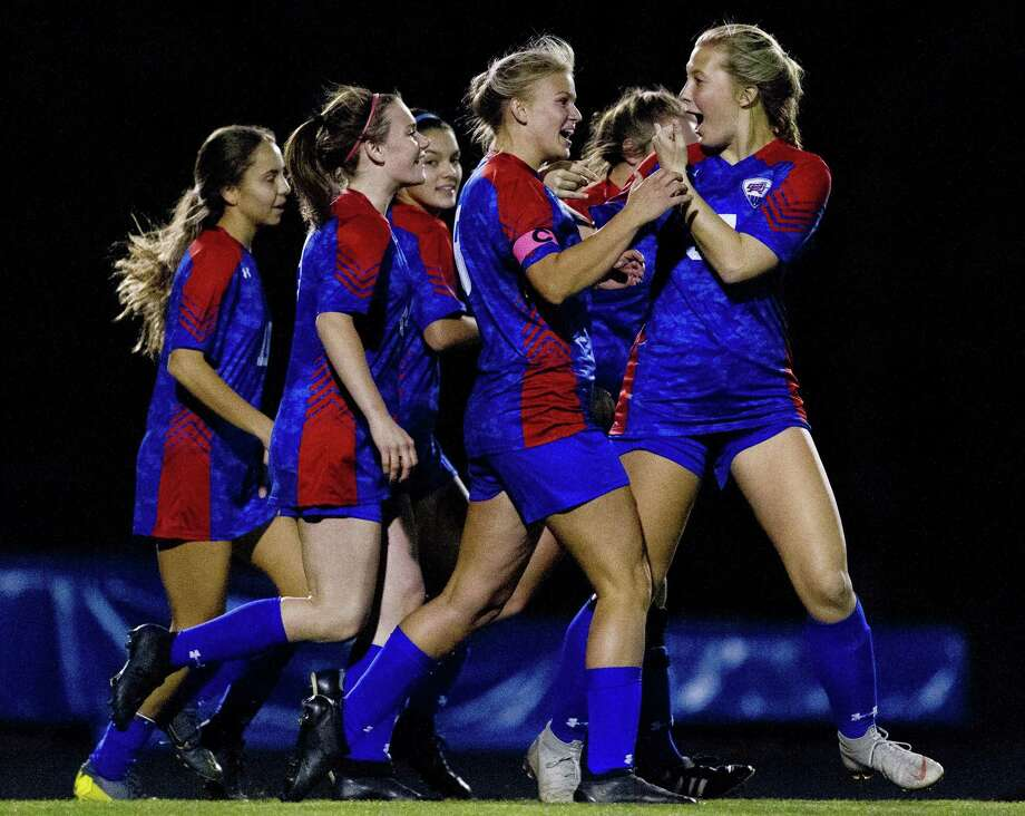 Oak Ridge forward Leila Anderson (8) reacts with midfielder Mikayla Garaux (37) after scoring a goal during the second period of a District 15-6A soccer match at Oak Ridge High School, Friday, March 15, 2019. Photo: Jason Fochtman, Houston Chronicle / Staff Photographer / © 2019 Houston Chronicle