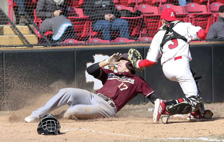 Alton catcher Owen Stendeback (right) tags Lockport's John Weis on head for an out at the plate to end the Porters' fifth inning Friday afternoon in the Prep Baseball Report Kickoff Classic at Babe Champion Field in Granite City. Photo: Greg Shashack / The Telegraph