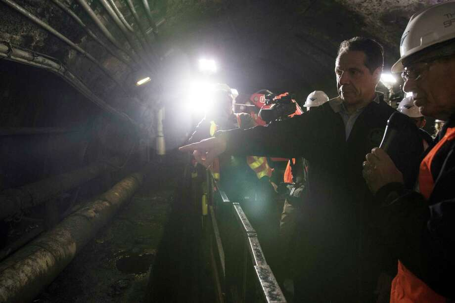 New York Gov. Andrew Cuomo inspects the South Tube of train tunnels running between New York and New Jersey during a tour that began Wednesday, Oct. 17, 2018. New York Gov. Andrew Cuomo wants President Donald Trump to get an up-close look at the level of damage in the century-old tunnel which was damaged in Superstorm Sandy in 2012. The Democrat toured the tunnel late Wednesday night and plans to send video to Trump in a bid to get the administration to commit money to a $13 billion project to build a new tunnel. (Victor J. Blue/The New York Times via AP, Pool) Photo: Victor J. Blue / 2018