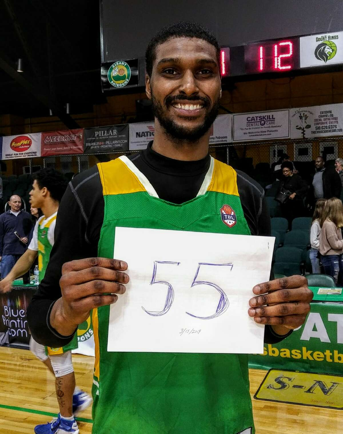 Edwin Ubiles poses with a sign signifying his 55-point game against New York on Friday, March 15, 2019. Ubiles set a franchise record. (Courtesy of Albany Patroons)