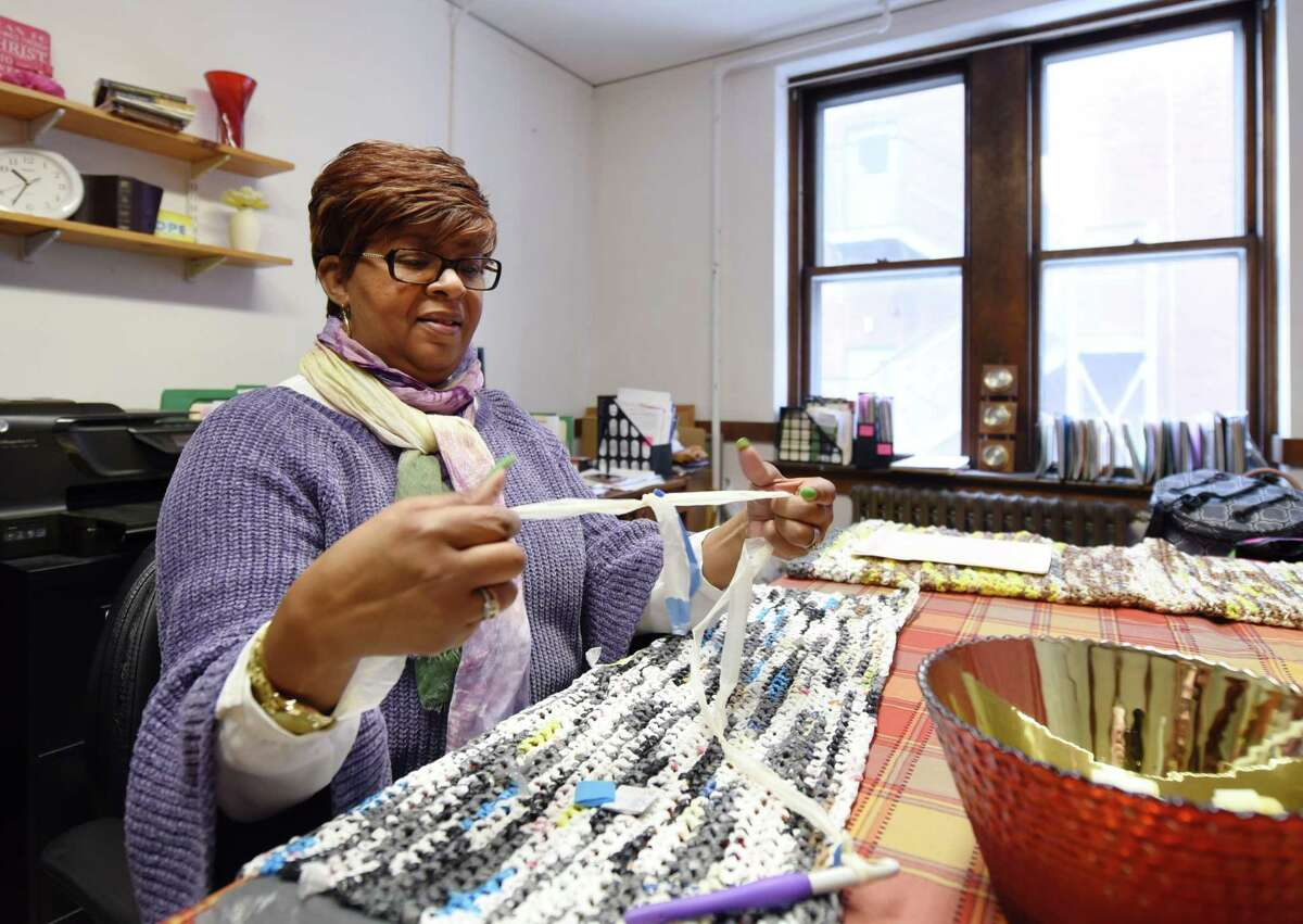Interim director of Focus Churches Renee Hollinshed uses single crochet to make mats from recycled plastic bags for the homeless Thursday, Feb. 21, 2019 at her office inside of Emmanuel Baptist in Albany, NY. (Phoebe Sheehan/Times Union)