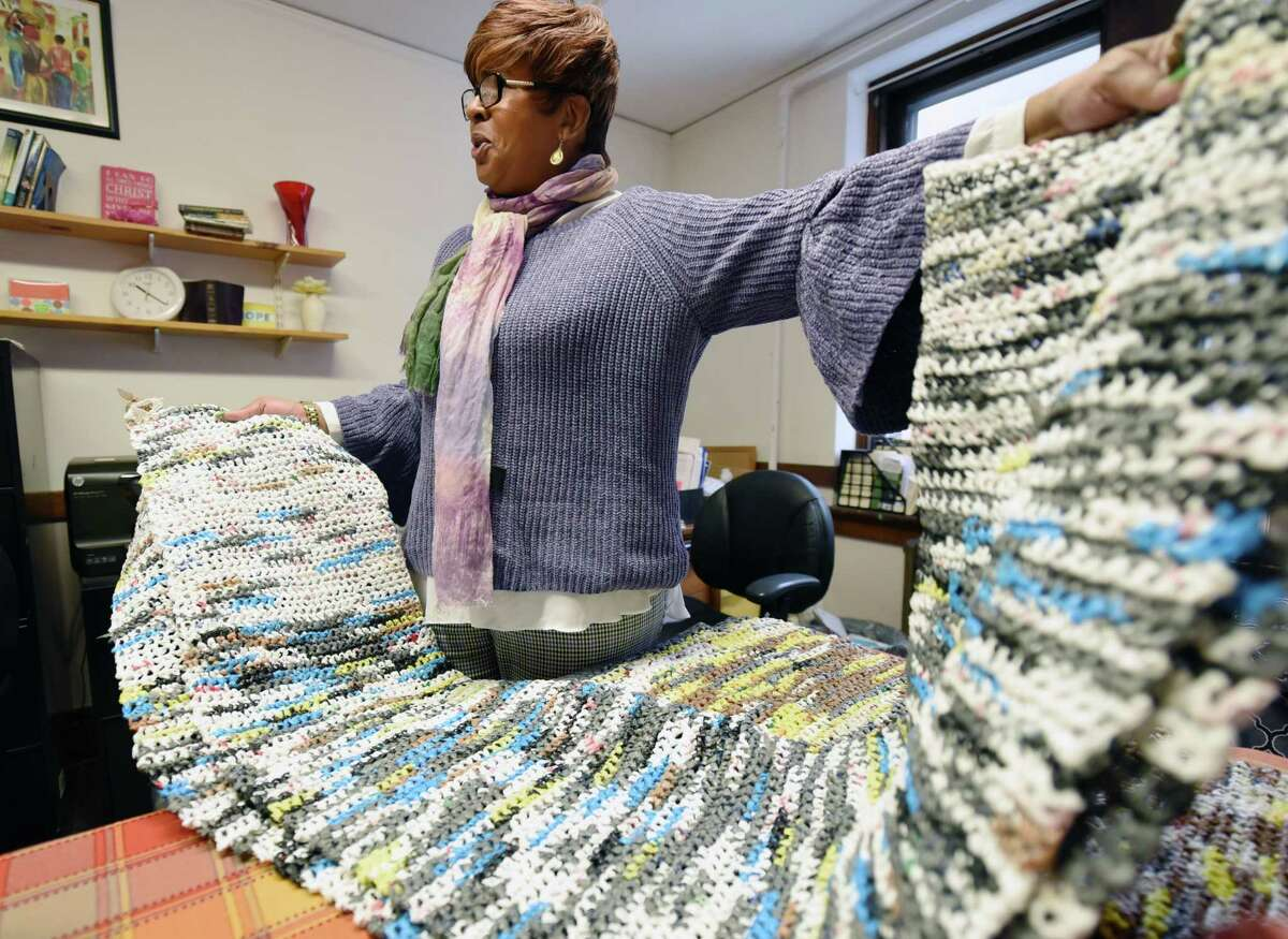 Interim director of Focus Churches Renee Hollinshed holds up a mat she crocheted from recycled plastic bags for the homeless Thursday, Feb. 21, 2019 at her office inside of Emmanuel Baptist in Albany, NY. (Phoebe Sheehan/Times Union)