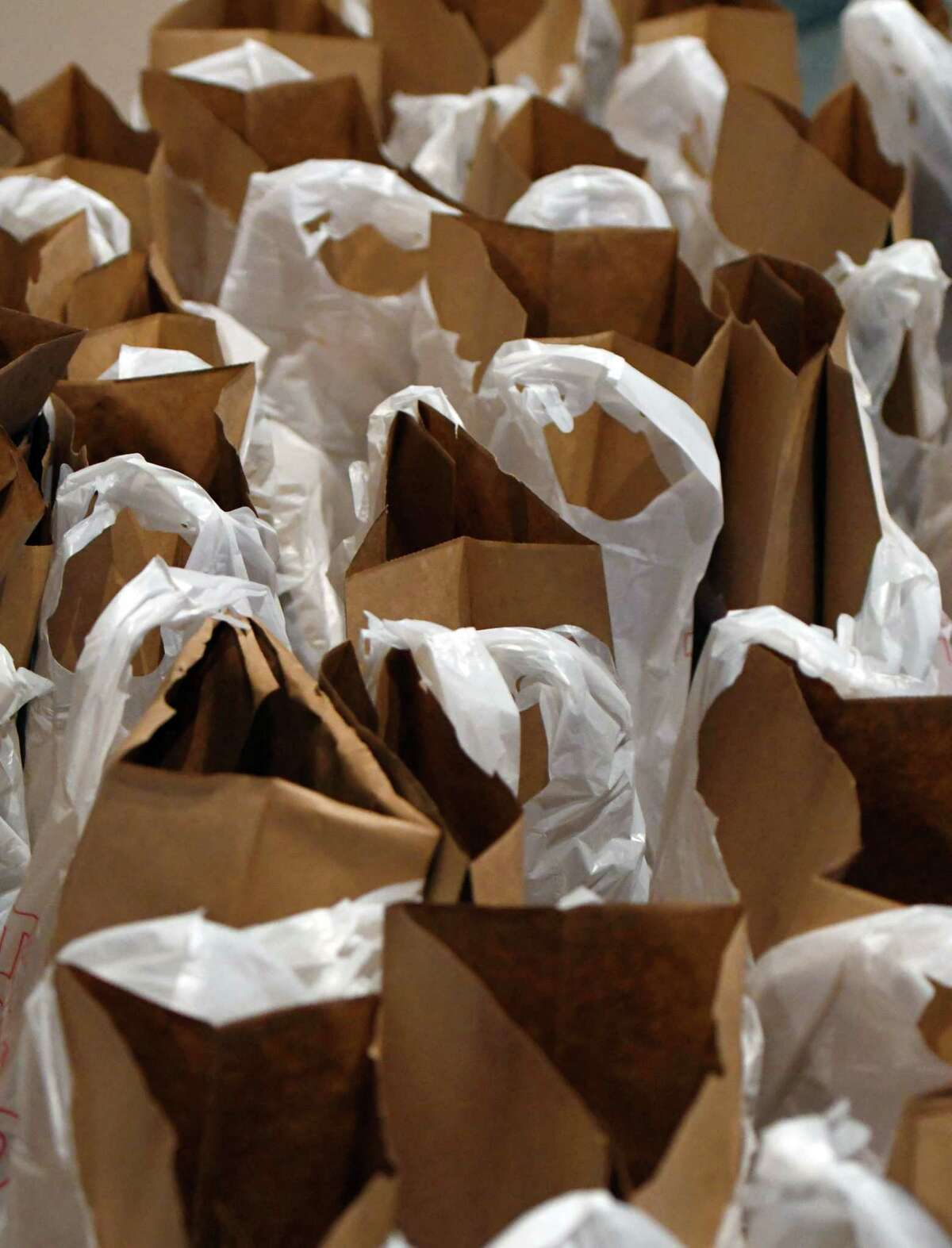 Bags are lined up for Focus Churches volunteers to fill with food to deliver to the elderly Thursday, Feb. 21, 2019 at Emmanuel Baptist in Albany, NY. (Phoebe Sheehan/Times Union)