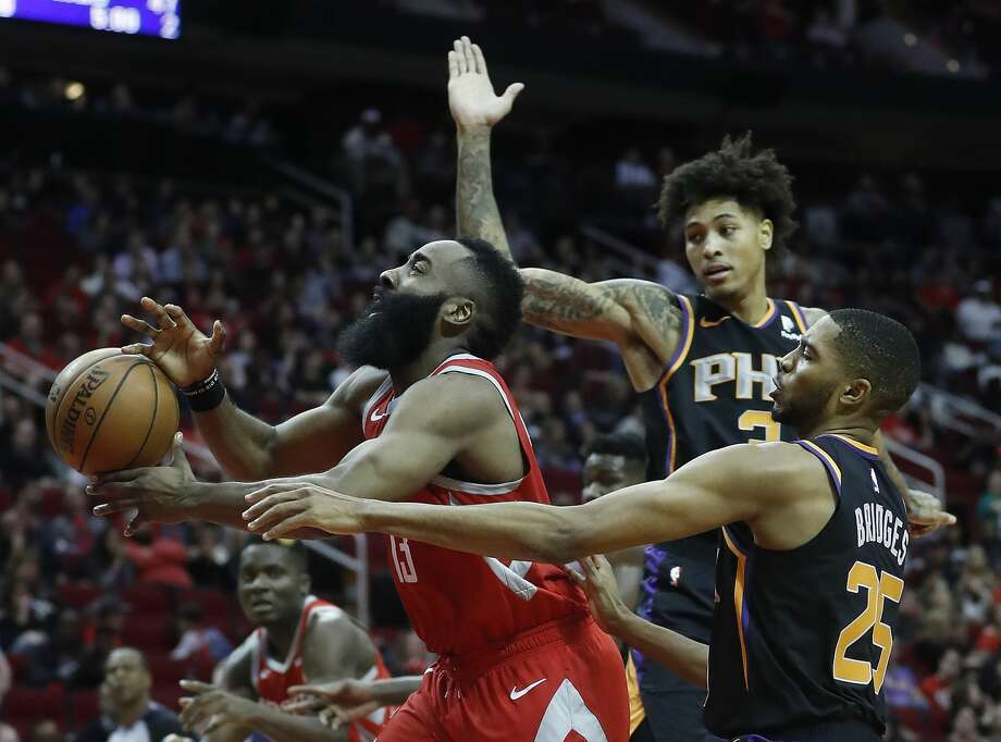 PHOTOS: Houston Rockets game-by-game Houston Rockets guard James Harden (13) is fouled going to the basket by Phoenix Suns forwards Mikal Bridges (25) and Kelly Oubre Jr. (3) during the first half of an NBA game at Toyota Center, Friday, March 15, 2019, in Houston. >>>See how the Rockets have fared in each game so far this season ... Photo: Karen Warren/Staff Photographer