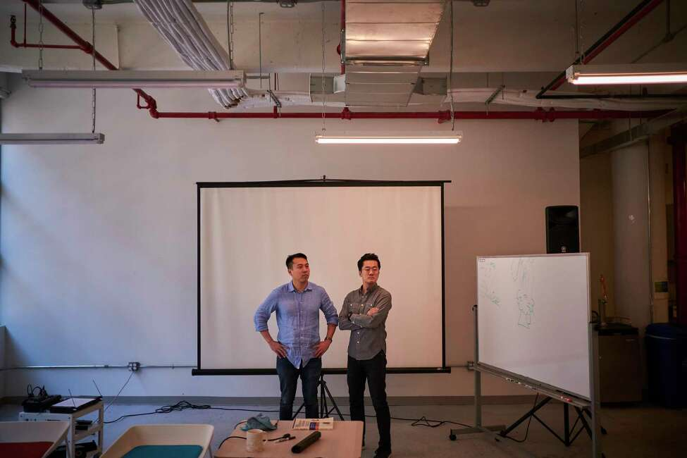 Jukay Hsu, founder and chief executive at Pursuit, left; and David Yang, co-founder and chief creative officer at Pursuit, at their headquarters in New York on March 5, 2019. Pursuit, a nonprofit jobs training program in Queens, is finding success at moving low-income New Yorkers into well-paying jobs. (John Taggart/The New York Times)