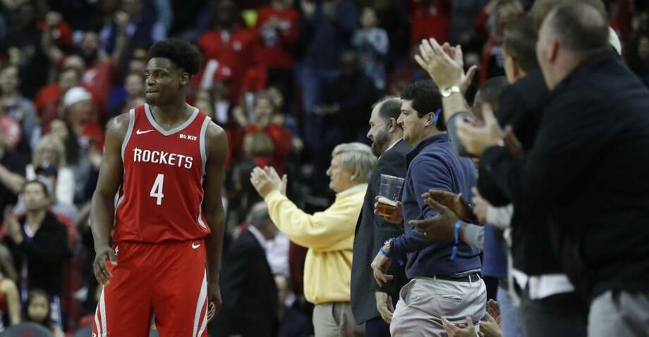 Houston Rockets forward Danuel House Jr. (4) high fives fans after a big three-pointer in the finals seconds during the second half of an NBA game at Toyota Center, Friday, March 15, 2019, in Houston.  Rockets won the game 108-102. Photo: Karen Warren/Staff Photographer