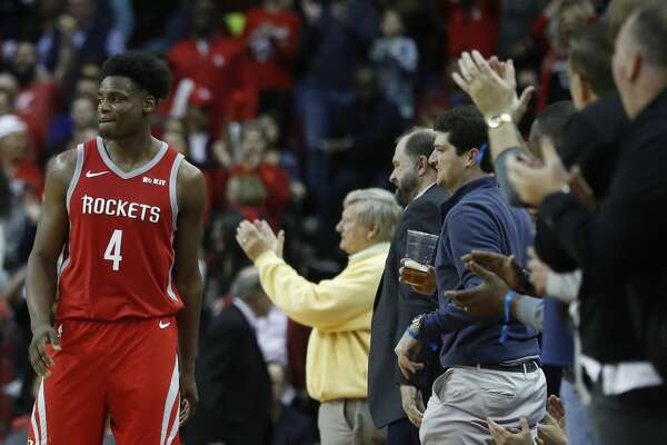 Houston Rockets forward Danuel House Jr. (4) high fives fans after a big three-pointer in the finals seconds during the second half of an NBA game at Toyota Center, Friday, March 15, 2019, in Houston. Rockets won the game 108-102.