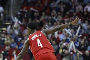 Houston Rockets forward Danuel House Jr. (4) reacts after one of his baskets during the first half of an NBA game at Toyota Center, Friday, March 15, 2019, in Houston.