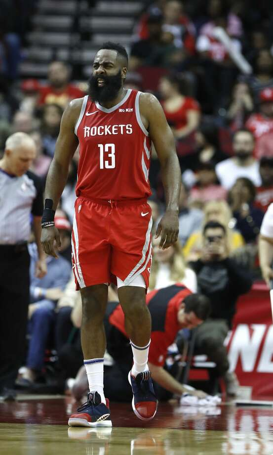 Houston Rockets guard James Harden (13) reacts after getting up slowly after crashing into Phoenix Suns center Deandre Ayton (22) during the second half of an NBA game at Toyota Center, Friday, March 15, 2019, in Houston.  Rockets won the game 108-102. Photo: Karen Warren/Staff Photographer