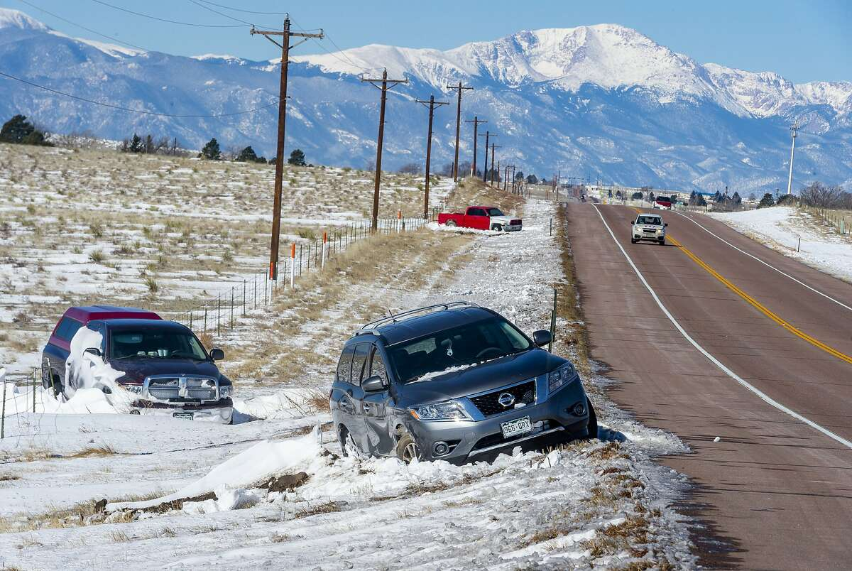 Abandoned cars remain on the side of state Highway 94 on in Yoder, Colo., Friday, March 15, 2019, two days after the '