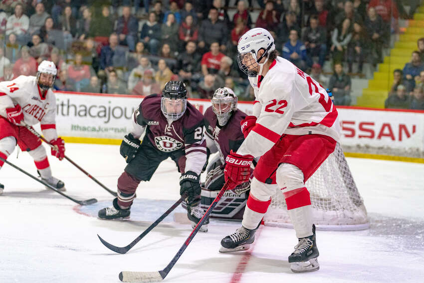 Jeff Malott of Cornell looks to cross the puck to Mitch Vanderlaan (14) as Union defenseman Michael Ryan and goalie Darion Hanson look on during Game 1 of their ECAC quarterfinal series at Lynah Rink on Friday, March 15, 2019. (Dave Burbank / Cornell Athletics)