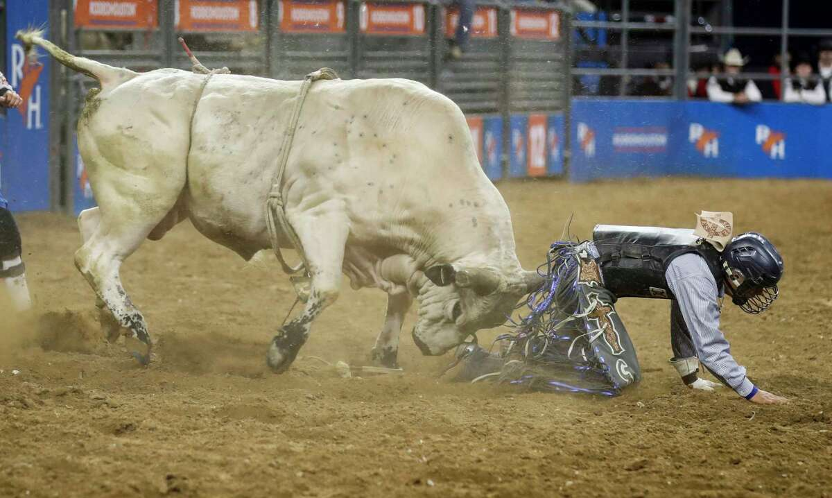 Foolish & Cruel goes after Chase Dougherty after he was thrown during RodeoHouston Wild Card round at NRG Stadium on Friday, March 15, 2019, in Houston.
